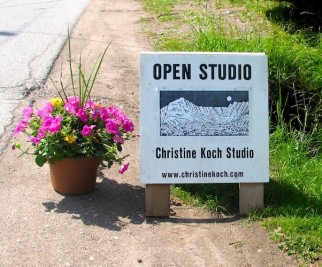 Woody Point studio signboard